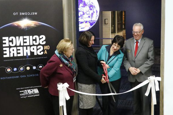"""Science On a Sphere"" Ribbon Cutting Ceremony From left to right: Mark Auslander (十大外围足彩网站 Director), Diane Byrum (MSU Board of Trustees Chair), April Clobes (MSU Federal Credit Union President and CEO), Teresa Sullivan (MSU Interim Provost)"